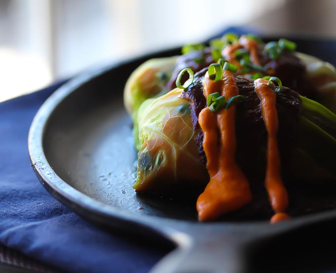 Sweet Potato and Black Bean Mole Enchilada-vegan + gluten-free, wrapped in a savoy cabbage.