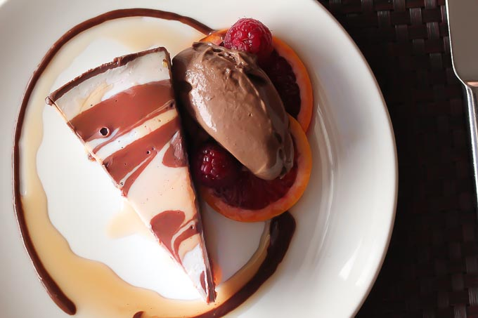 A show-stopping blood orange and chocolate raw vegan cheesecake makes a beautiful and healthy dessert!