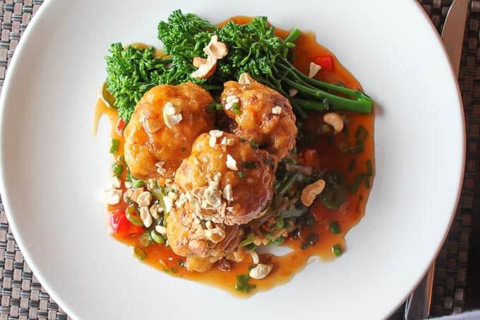 Vegan General Tsao's Cauliflower has a delicious sauce, crispy cauliflower and healthy steamed broccoli