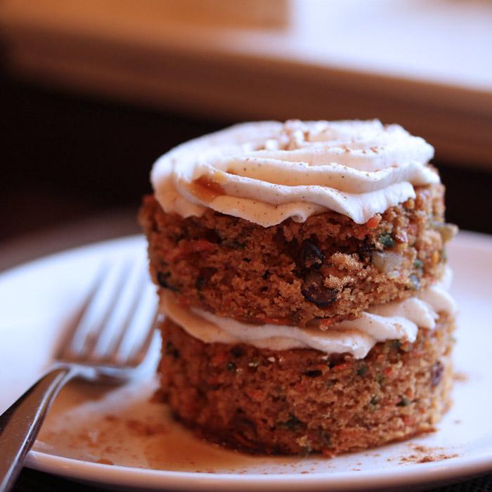 Vegan Carrot Cake with walnuts, raisins and vegan cream cheese frosting