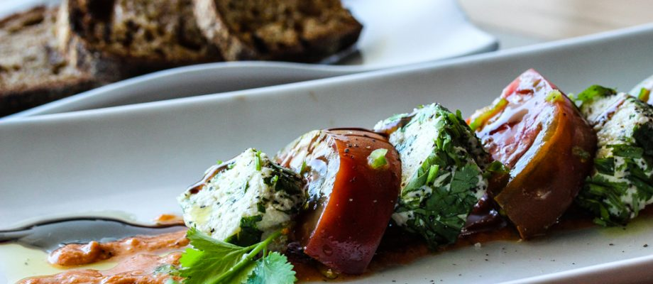 Raw vegan cashew ricotta makes a great caprese salad with fresh basil and heirloom tomato!