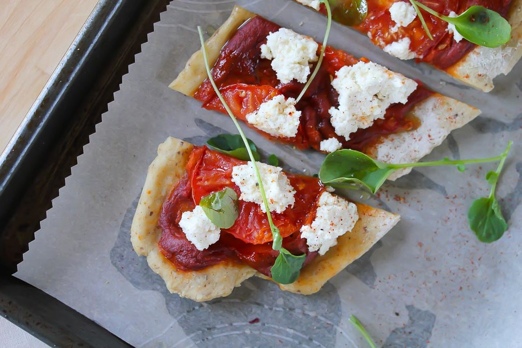 Romesco Pizza with tomato and watercress