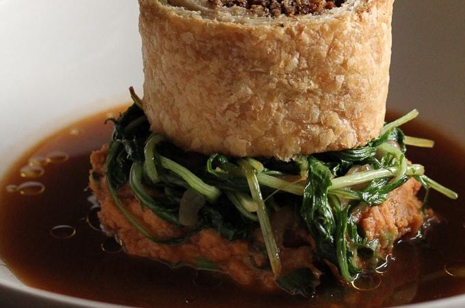Portobello Wellington with pecans and sage