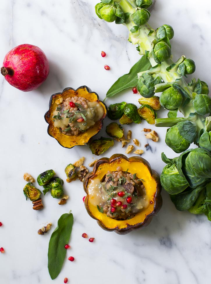Baked acorn squash with hearty mushrooms and barley is a lovely and filling entree.