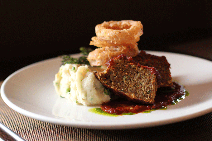 Vegan meatloaf with mashed potatoes, barbecue sauce and vegan gravy