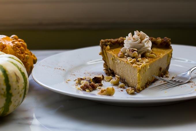 Raw vegan pumpkin pie is a perfect dessert to bring to a harvest dinner.