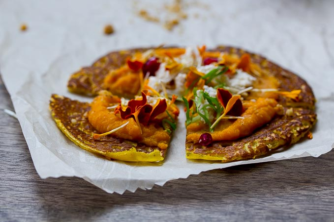 Socca with roasted butternut hummus makes a delicious and light snack or party appetizer. Naturally gluten-free, they can be made thick like pancakes or thin like crepes. The flavor is absolutely addictive!