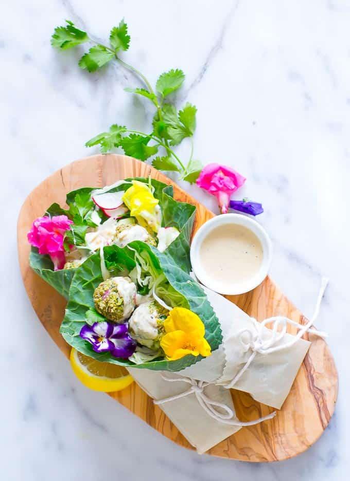 Raw vegan falafel wrapped in collard greens with a bright citrus tahini sauce!
