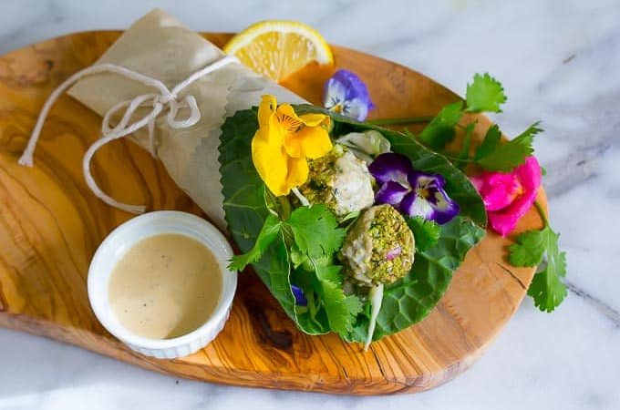 Raw vegan falafel wrapped in collard greens with a bright citrus tahini sauce!