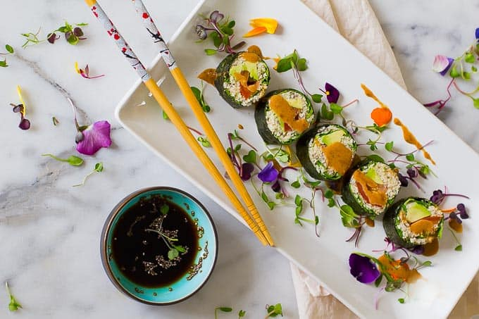 Paleo vegan sushi with cauliflower chia rice and a spicy chili almond sauce. Raw, gluten-free, grain-free and nutrient dense.