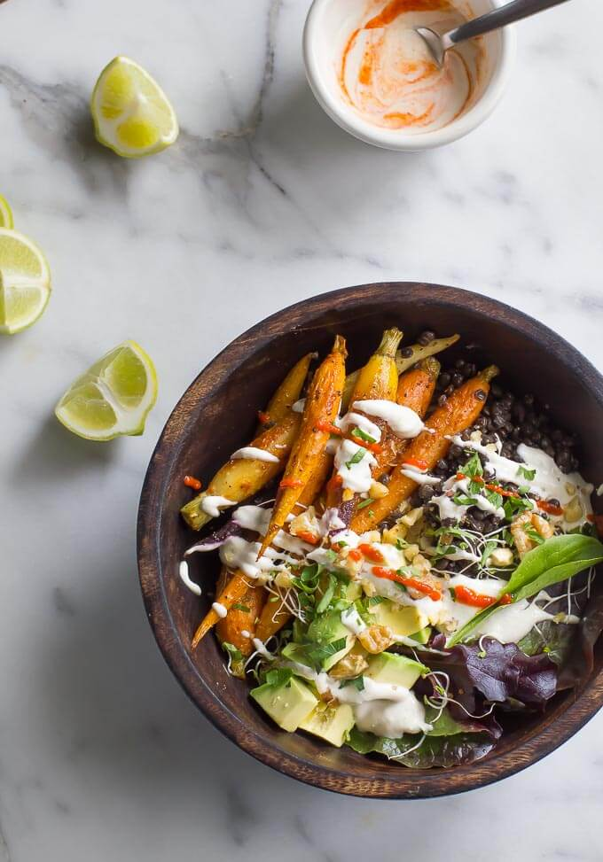 A Buddha Bowl is a great way to approach a healthy, well rounded diet and get dinner on the table in a hurry! Roasted carrots, quinoa and black lentils are a trio of powerhouse nutrition, and are delicious paired with a simple cashew yogurt!