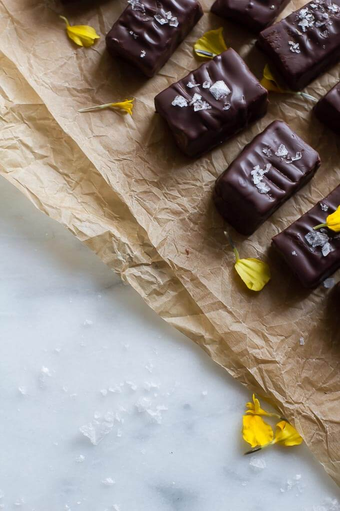 Enrobed in dark vegan chocolate, these salted caramel truffles are healthy and easy to make. And did I mention they're raw?