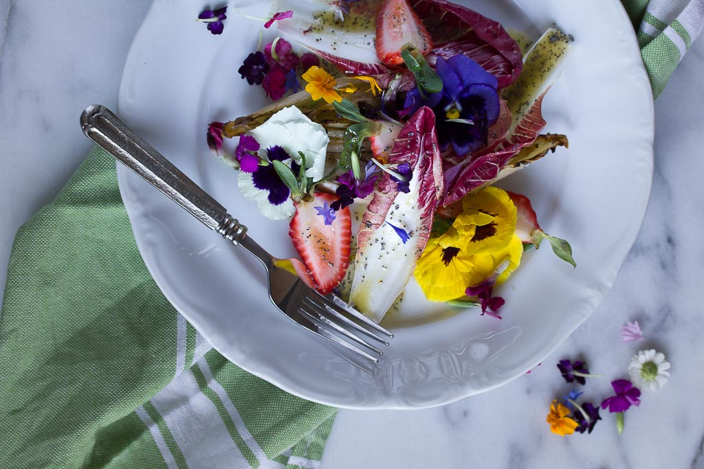 Endive Strawberry and Pansy Salad with lemon poppy seed vinaigrette