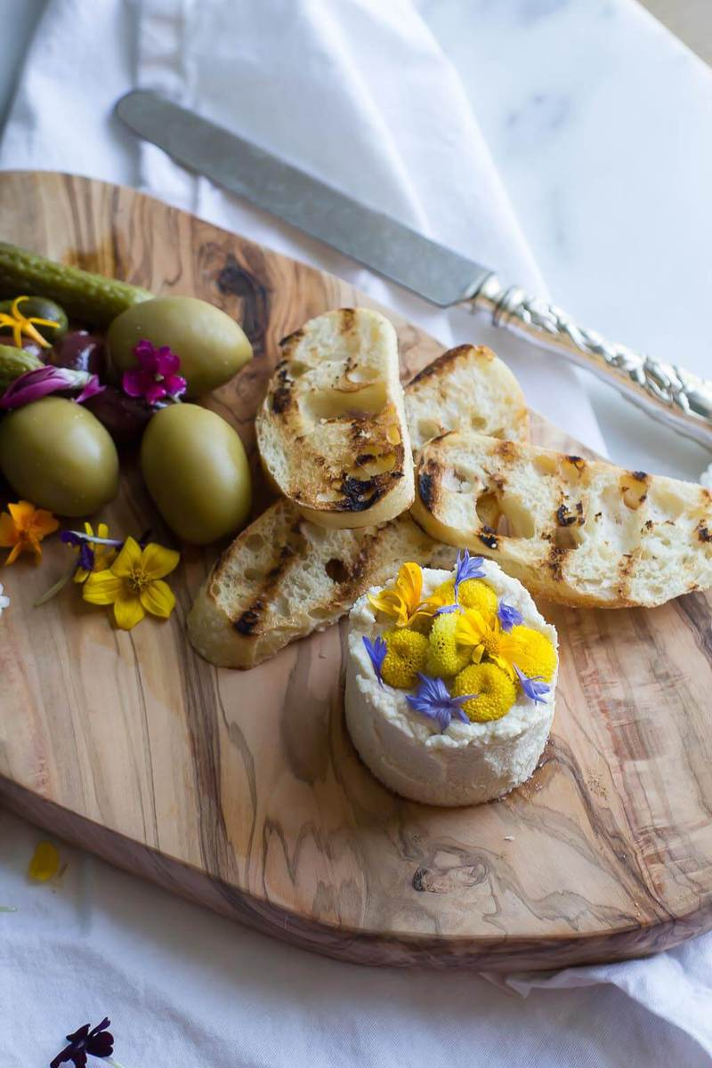 """Easy vegan """"goat cheese"""" with just 4 simple ingredients, and ready in 5 minutes! This recipe makes a wonderful vegan cheese board as well."""