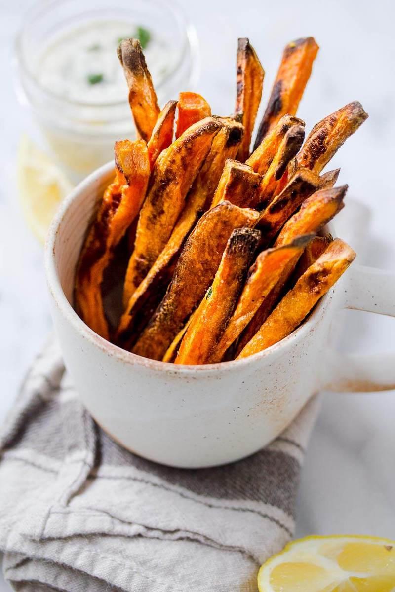Baked Sweet Potato Fries with vegan lemon caper aioli makes an addictively tasty treat!